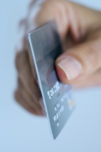 Paying with Debit Card --- Image by © Royalty-Free/Corbis