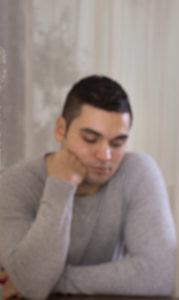man thinking_grey sweater